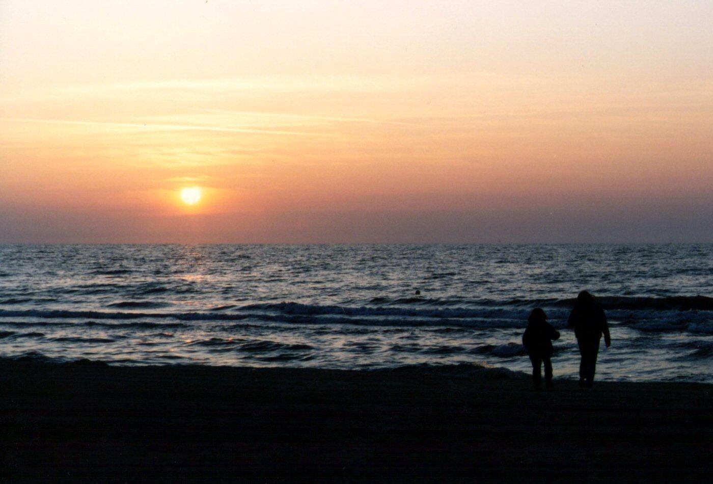 Photographie D Un Coucher De Soleil Sur La Mer